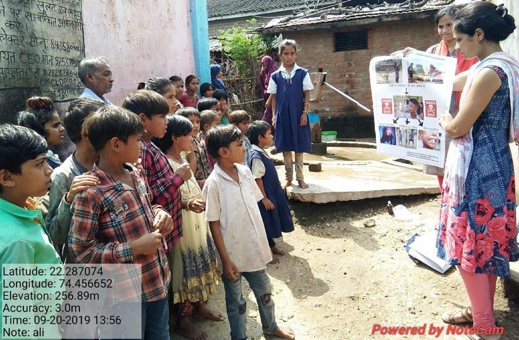 Community children learning about fluoride in India